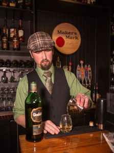 "Owner Ryan Wallace pouring his favorite whiskey, Glidden Fitch 12. This was the first whiskey that made him think there was ""something to it"""